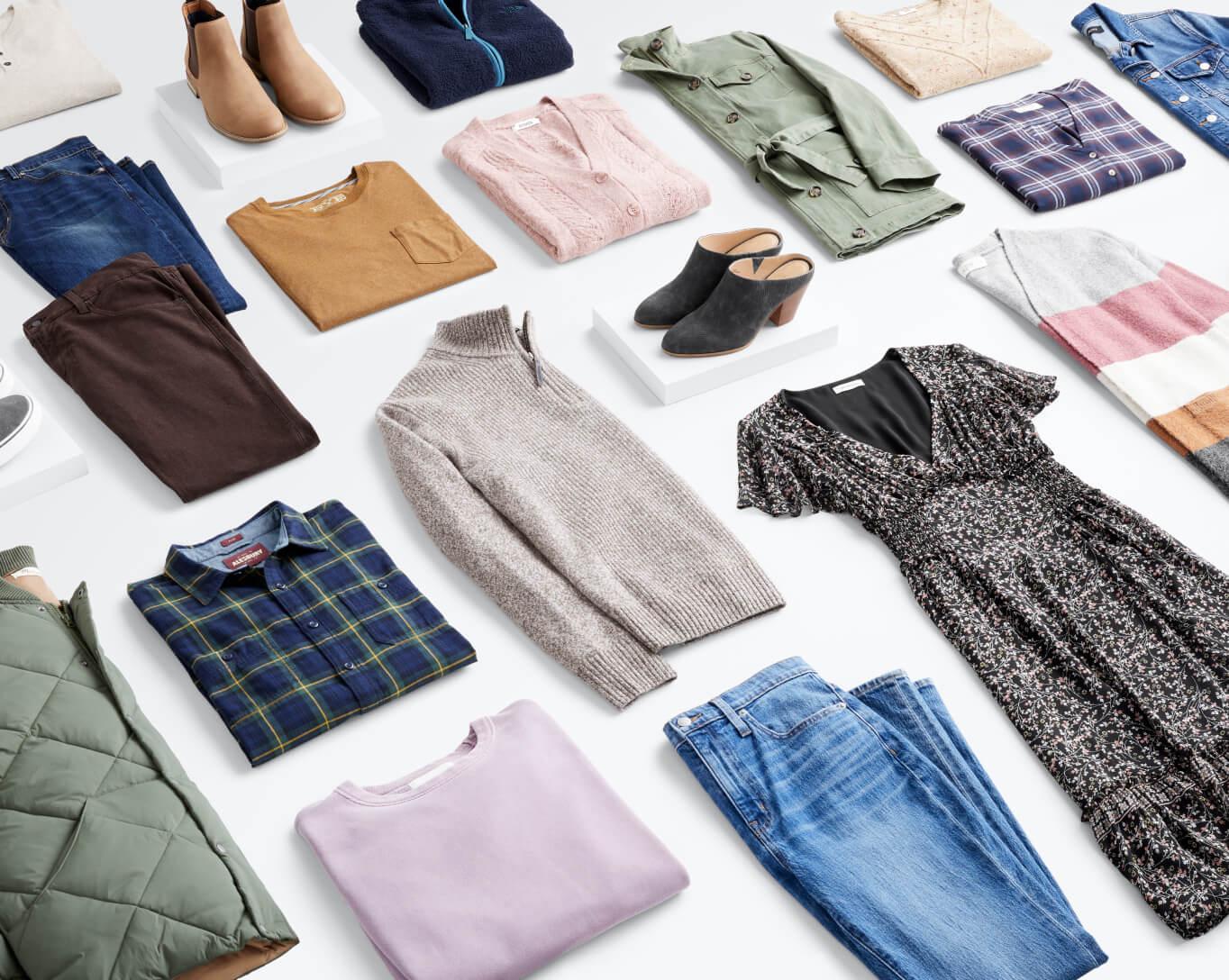 Stitch Fix men's and women's clothing assortment folded.