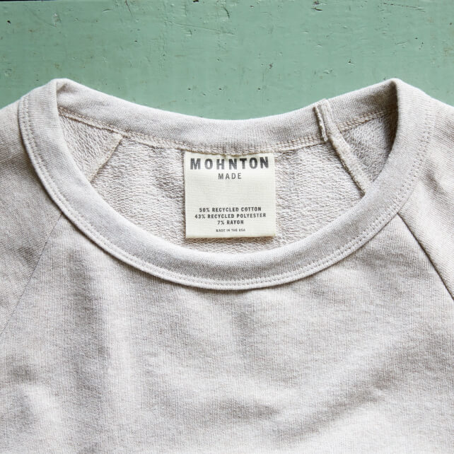 Mohnton Made tag in beige crew neck shirt.
